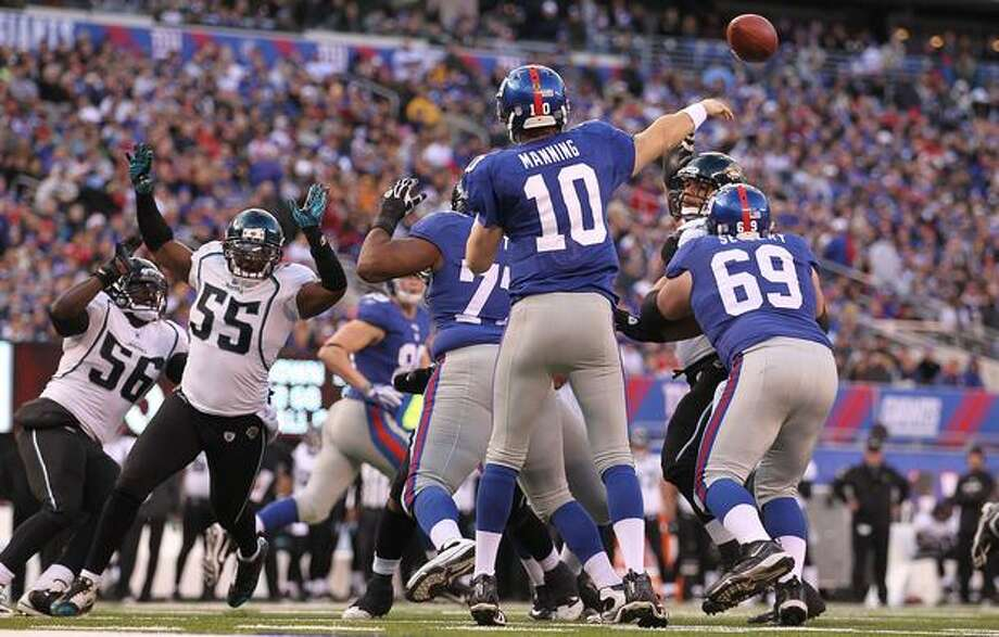 No. 8: New York Giants quarterback Eli Manning, shown here throwing a pass against the Jacksonville Jaguars on Nov. 28, 2010 at the New Meadowlands Stadium, in East Rutherford, New Jersey. Photo: Getty Images