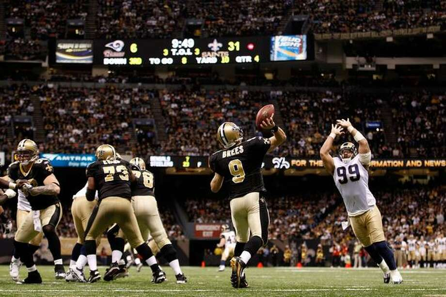 No. 2: New Orleans Saints quarterback Drew Brees, shown here throwing a pass against the St. Louis Rams on Dec. 12, 2010 at the Louisiana Superdome, in New Orleans. Photo: Getty Images