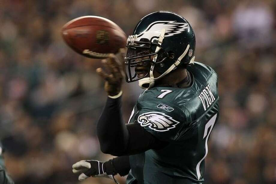 No. 6: Philadelphia Eagles quarterback Michael Vick, shown here throwing a pass against the Minnesota Vikings on December 26, 2010 at Lincoln Financial Field, in Philadelphia. Vick wasn't even the starter at the beginning of the year. Vick jersey sales would seem to show public acceptance following his conviction and prison term for dog fighting. Photo: Getty Images
