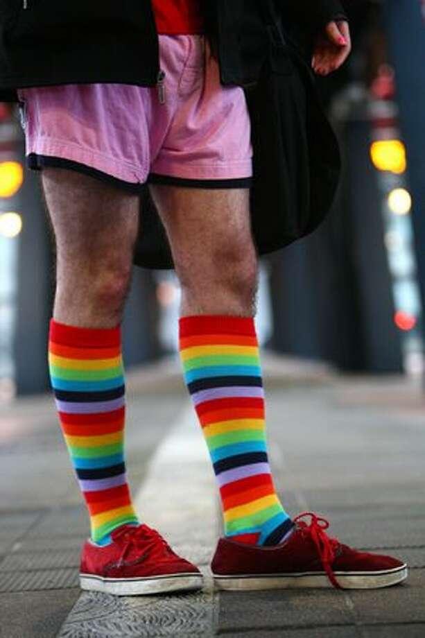 "A passenger sports colorful socks during Seattle's ""No-Pants Light Rail Ride."" Photo: Joshua Trujillo, Seattlepi.com"