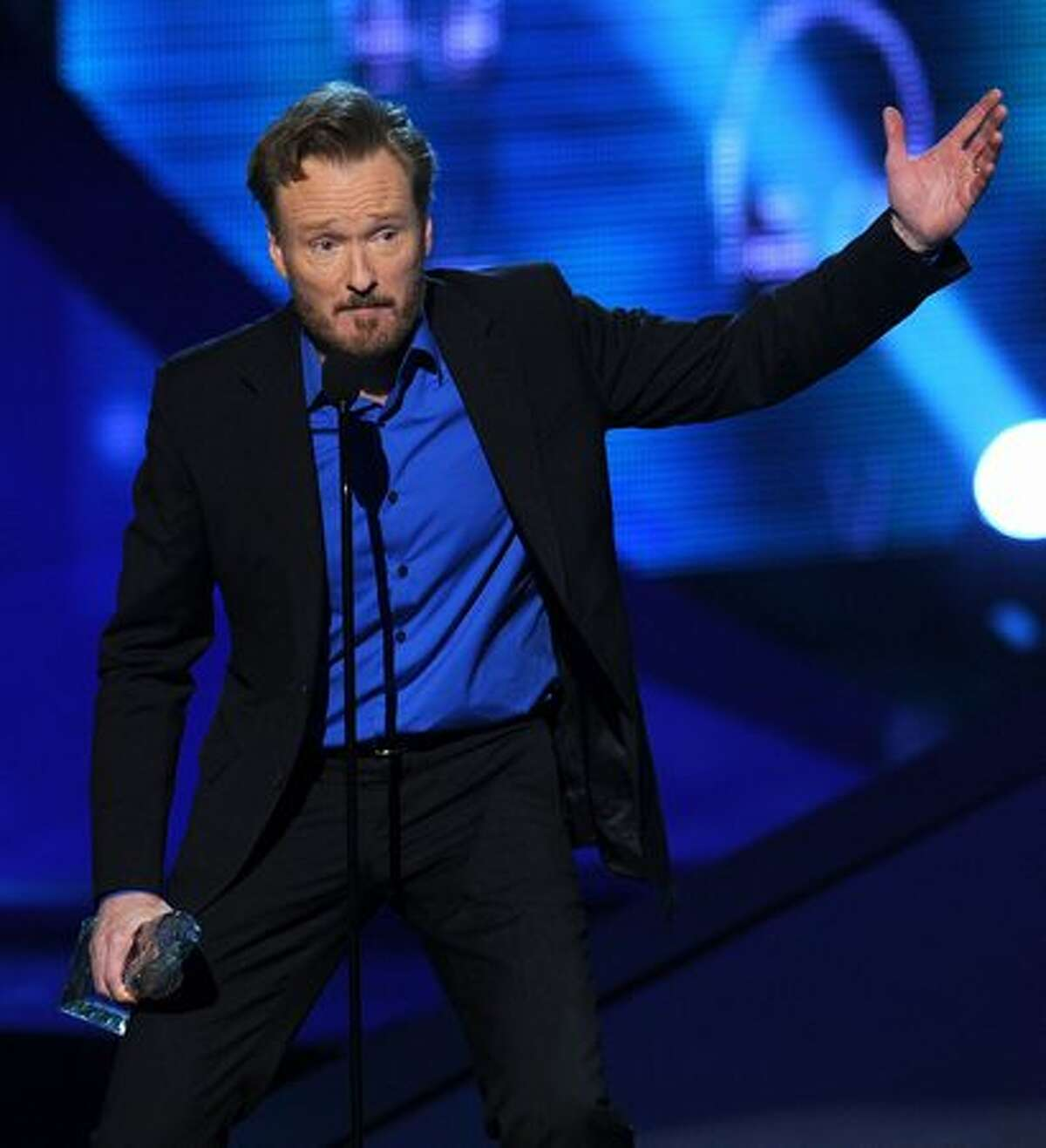 TV personality Conan O'Brien accepts the Favorite Talk Show Host award onstage during the 2011 People's Choice Awards at Nokia Theatre L.A. Live in Los Angeles, California.