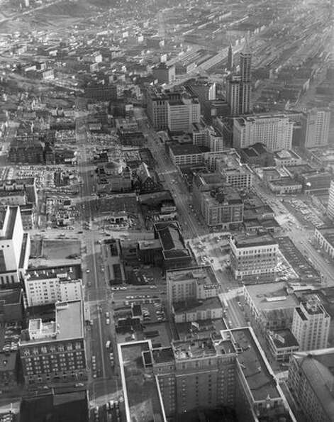 An aerial photo of downtown Seattle with the Smith Tower in the upper right.
