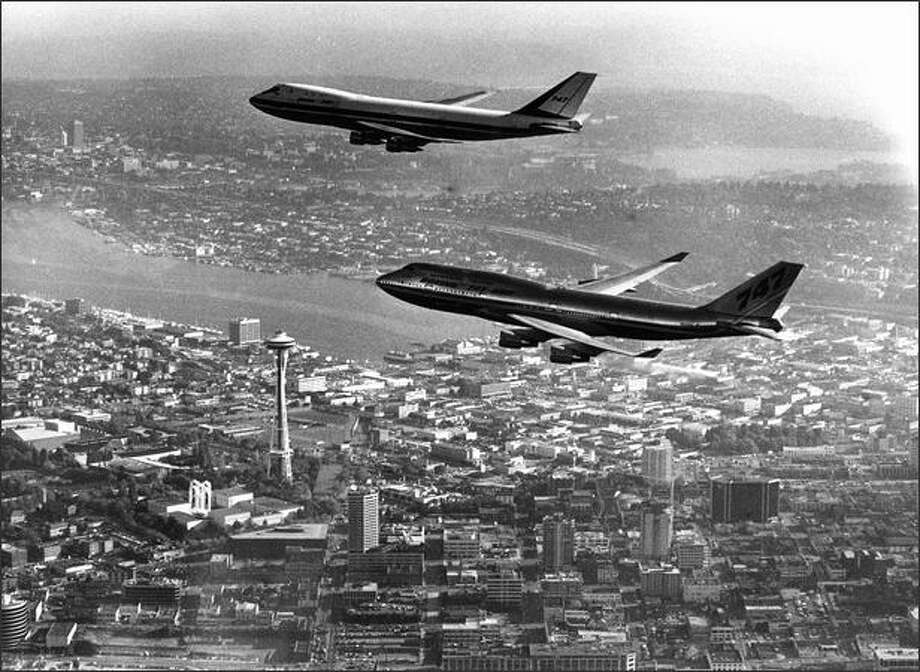 In 1988 the first 747 and the latest version at the time, the 747-400, fly over Seattle. Photo: Phil H. Webber, Seattle Post-Intelligencer