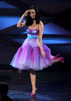 Singer Katy Perry aka Katy Brand accepts the Favorite Female Artist and Favorite Online Sensation awards onstage during the 2011 People's Choice Awards at Nokia Theatre L.A. Live in Los Angeles, California. Photo: Getty Images