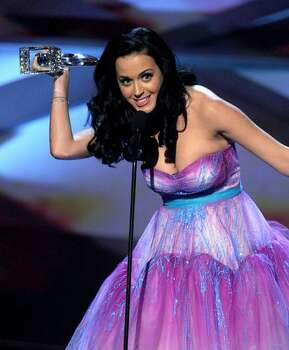 Singer Katy Perry aka Katy Brand accepts the Favorite Female Artist and Favorite Pop Artist awards onstage during the 2011 People's Choice Awards at Nokia Theatre L.A. Live in Los Angeles, California. Photo: Getty Images