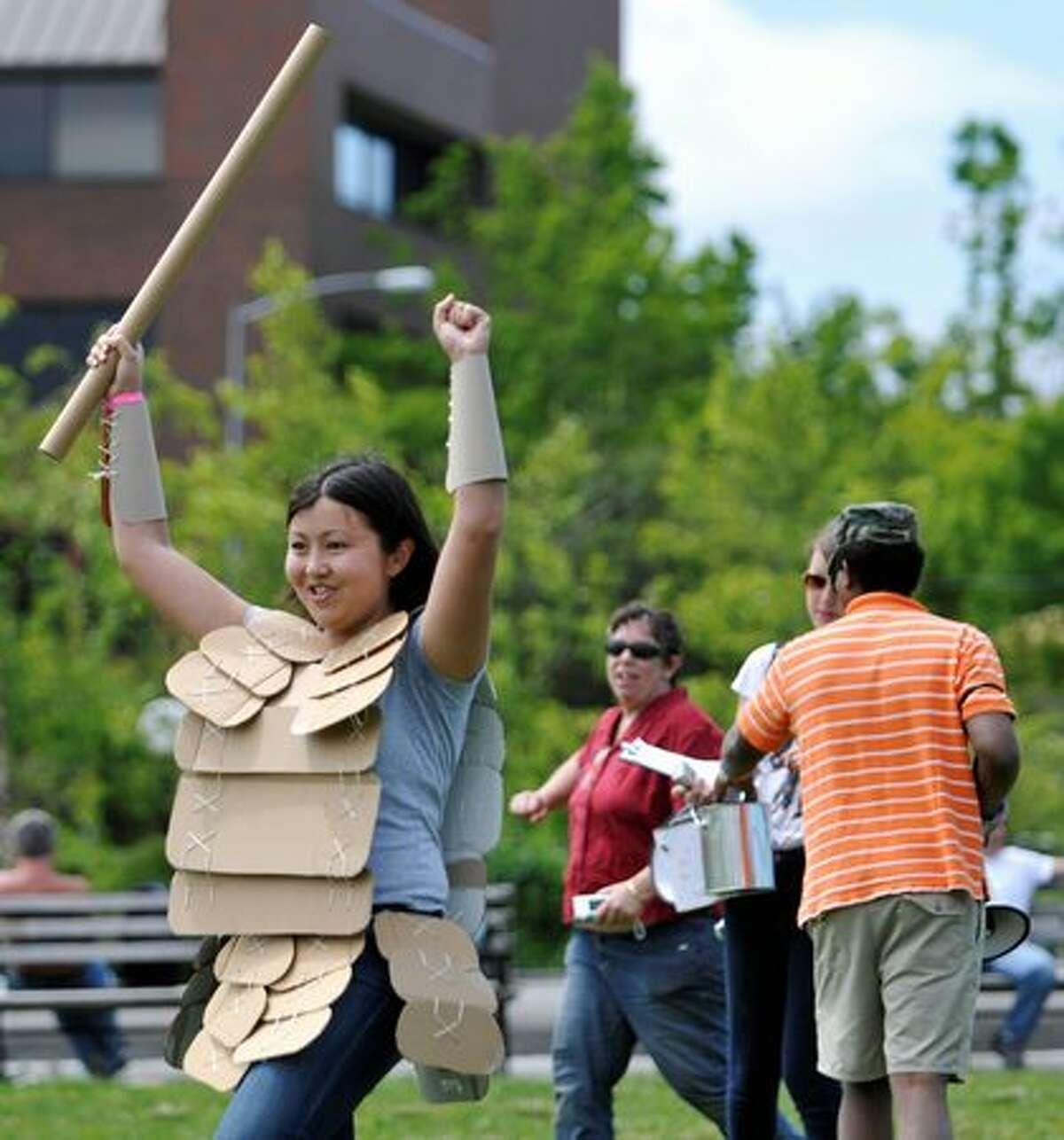 Indira Ismailova celebrates her cardboard sword fight victory.