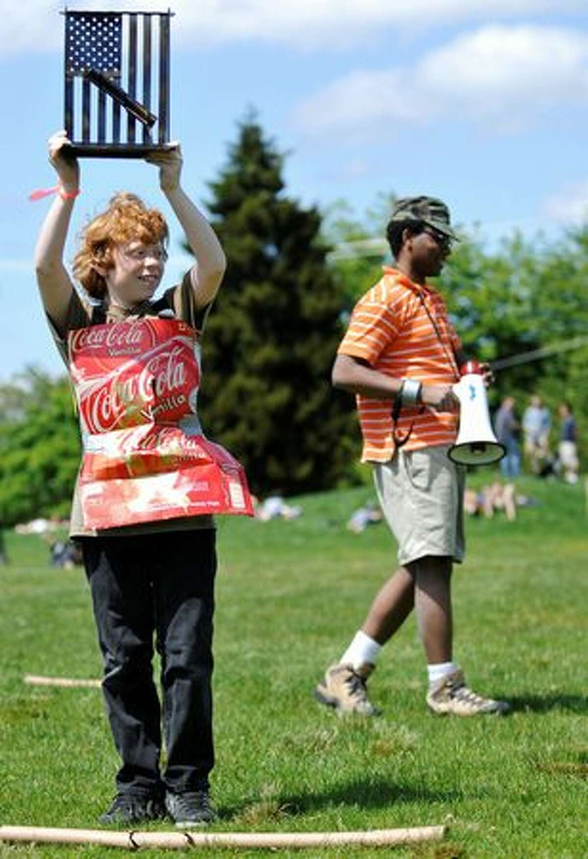 Sam David holds up his trophy for winning the Old Glory Cardboard Tube Fight competition.