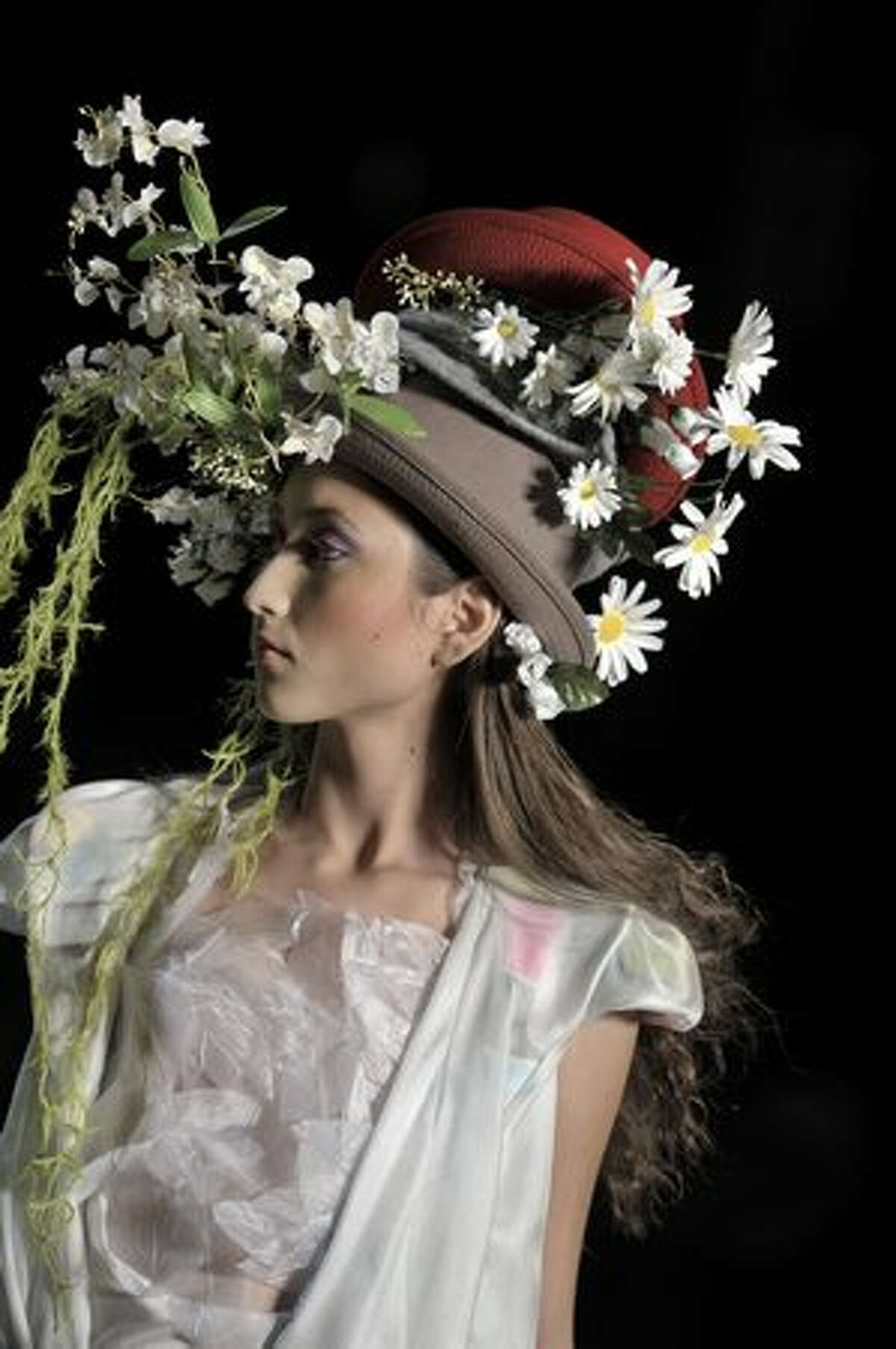 A model presents a creation by Brazilian designer Erika Ikezili during the opening day of the 2010-2011 Spring-Summer collections of the Sao Paulo Fashion Week in Sao Paulo, Brazil.