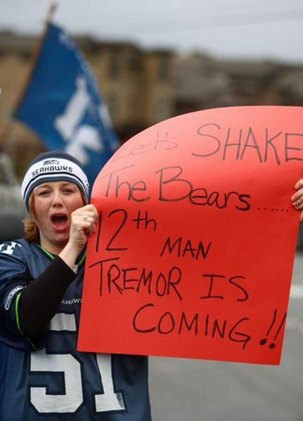 Alicia Brender holds a sign as Seattle Seahawks team busses drive past during a fan sendoff for the team on Friday, Jan. 14, 2011 near the Virginia Mason Athletic Facility in Renton. The Seahawks are scheduled to play the Chicago Bears Sunday in an NFL playoff game.