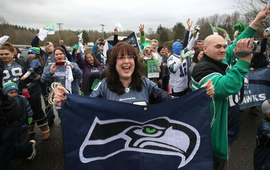 Fans cheer as team busses drive past during a fan sendoff for the Seattle Seahawks near the Virginia Mason Athletic Facility in Renton. Photo: Joshua Trujillo, Seattlepi.com