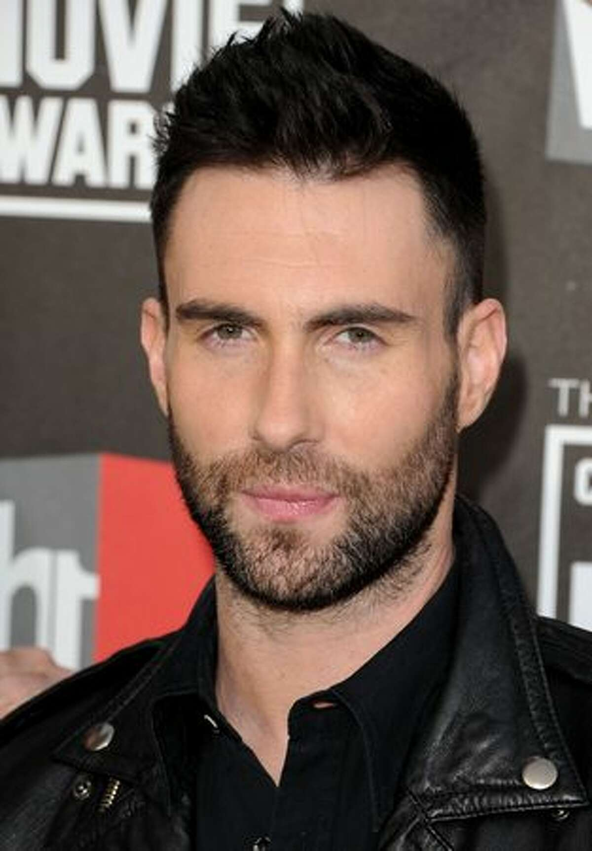 Singer Adam Levine from the musical group Maroon 5 arrives.