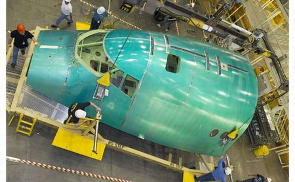 Boeing starts assembly of the first 747-8 Intercontinental fuselage section at its wide-body plant in Everett.