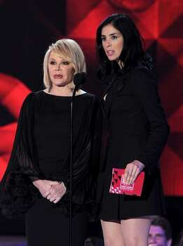 TV personality Joan Rivers (L) and comedian Sarah Silverman speak onstage. Photo: Getty Images
