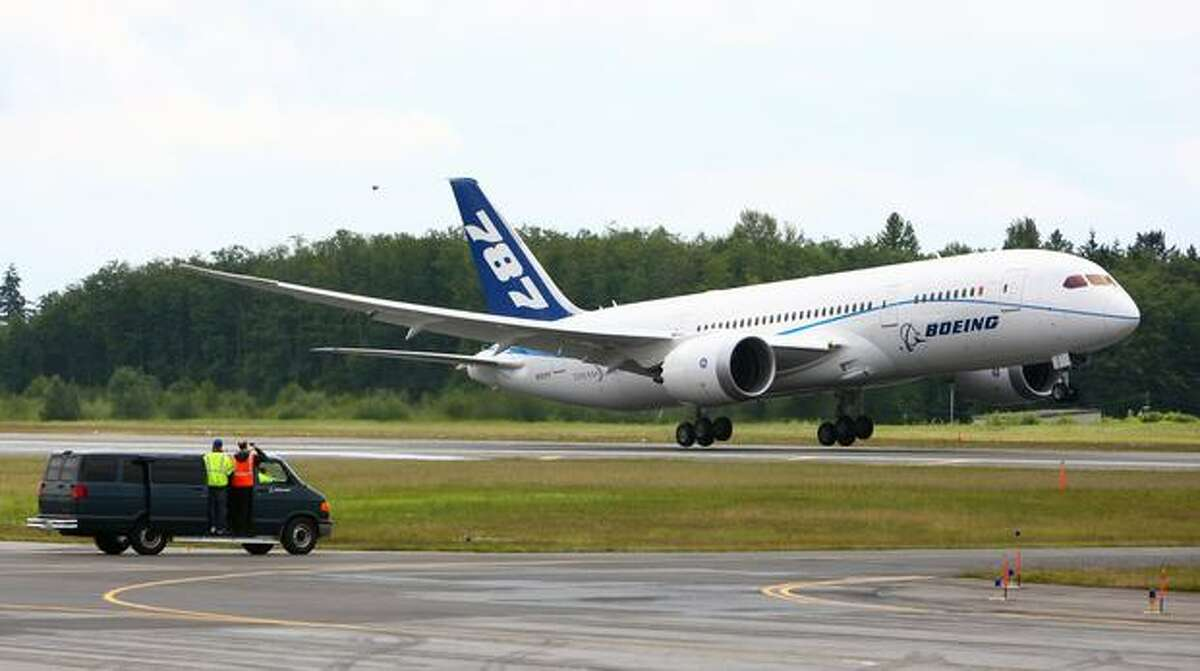 A Boeing 787 takes off during the first flight of the Boeing 787 powered with General Electric's GEnx engines on Wednesday.