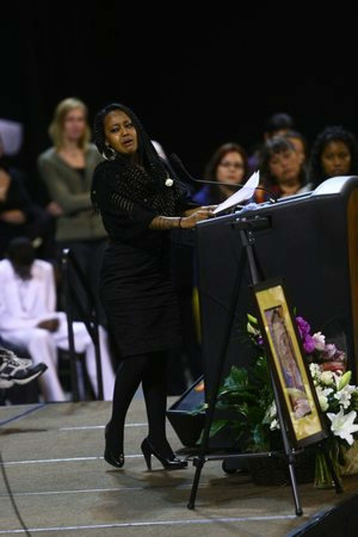 Immediate family members are overcome with emotion during the funeral service at KeyArena Friday.
