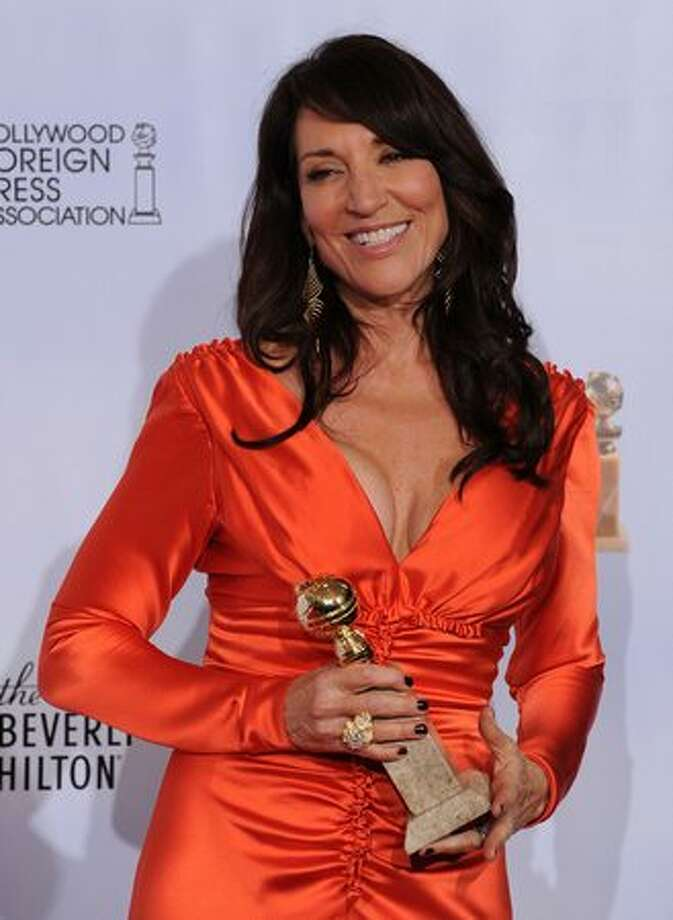 "Actress Katey Sagal poses with her award for Best Performance by an Actress In A Television Series (Drama) for ""Sons of Anarchy"" in the press room. Photo: Getty Images"