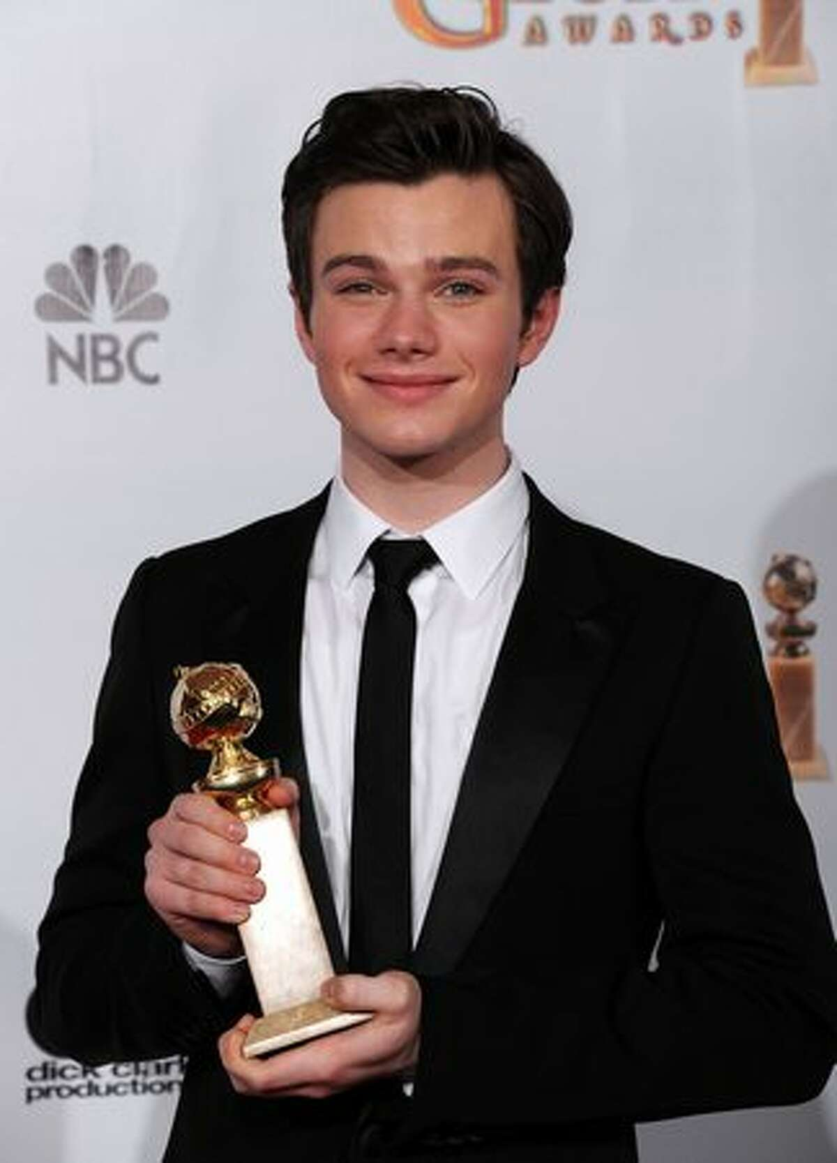 Actor Chris Colfer poses with his award for Best Performance by an Actor in a Supporting Role in a Series, Mini-Series or Motion Picture Made for Television for