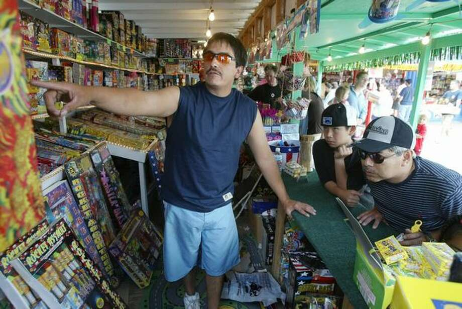 Edwin Poulia at The Love Shack fireworks stand at the Muckleshoot Indian Reservation, July 2004. Photo: P-I File