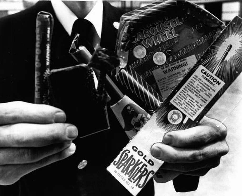 "David Campbell, assistant fire marshal, shows ""safe and sane"" fireworks on June 27, 1975. Photo: P-I File"