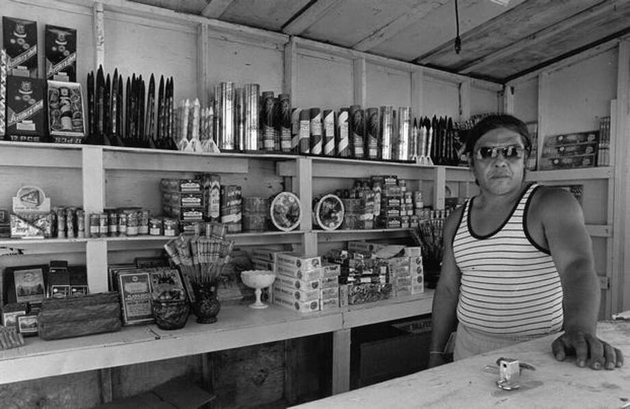 Been Nelson Mans at a fireworks booth on the Puyallup Indian Reservation on June 19, 1987. Photo: P-I File