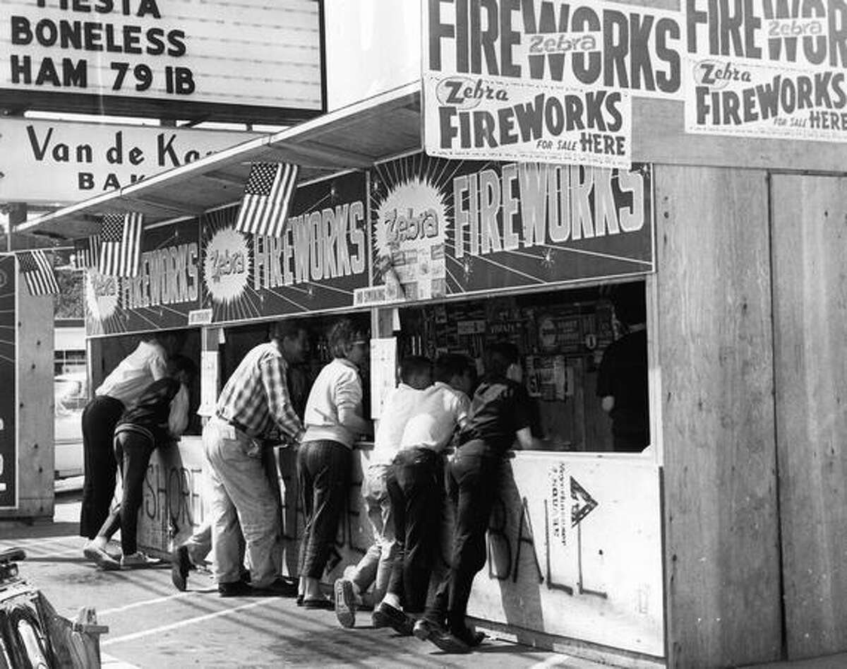 Customers at a Kenmore fireworks stand on July 2, 1963.