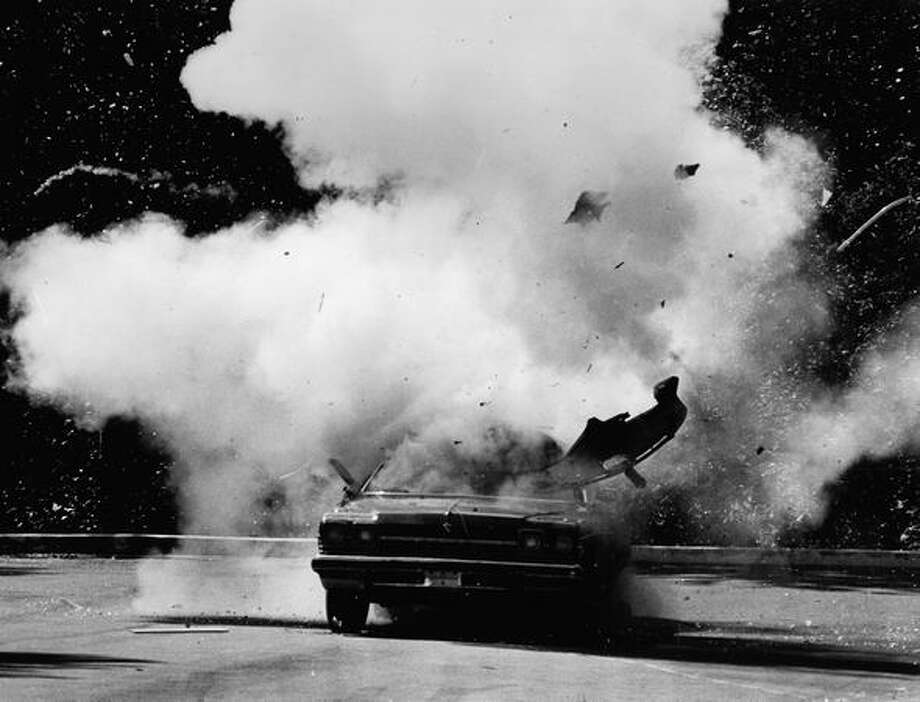 A car is blown up with a box of M-80 firecrackers that detonated all at once during a June 1985 demonstration. Photo: P-I File