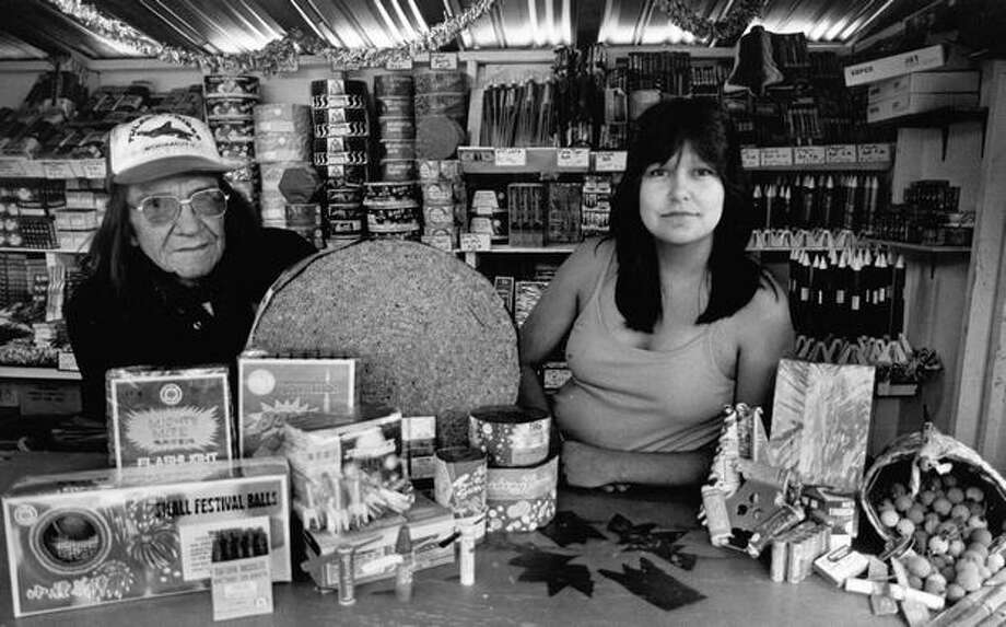Lawrence Jones and Christy Baker ran the Silver Eagle Fireworks stand at Boom City on July 9, 1984. Photo: P-I File