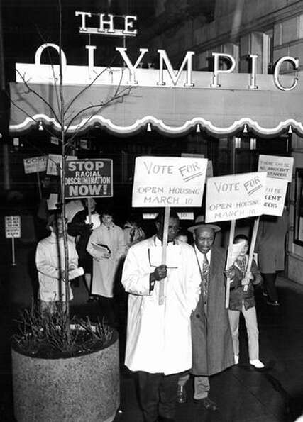 The Jan. 28, 1964 photo caption read: CORE pickets at Seattle Real Estate Board meeting. 58 pickets