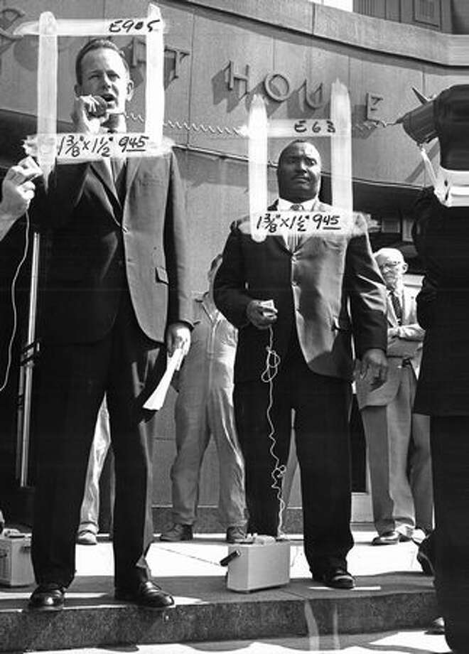 This Aug. 1963 photo shows District Attorney Brock Adams with State Rep. Sam Smith at a civil rights demonstration. (Bob Jackson/seattlepi.com file) Photo: P-I File