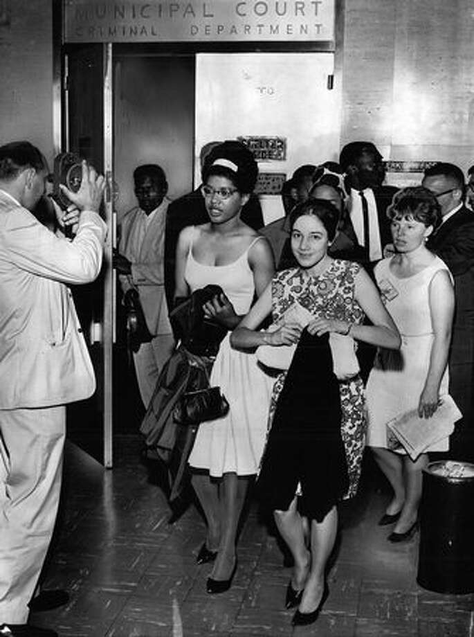 The July 26, 1963 photo caption read: Defendants and attorneys involved in sit-in charges emerge from police court after cases were continued until Aug. 14. (seattlepi.com file) Photo: P-I File