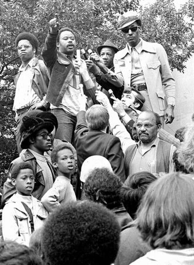 "The photo caption from this previously unpublished P-I photo from June 15, 1972 read: Tyree Scott, after Judge Wm. Lindberg said he'd delay ruling on UCWA's proposed involvement in recruiting and dispatch of minorities until Wednesday, told the crowd: ""We're not going to wait."" At left of Tyree is Larry Gossett, another black activist. [Gossett is now a King County Councilman.] (seattlepi.com file) Photo: P-I File"