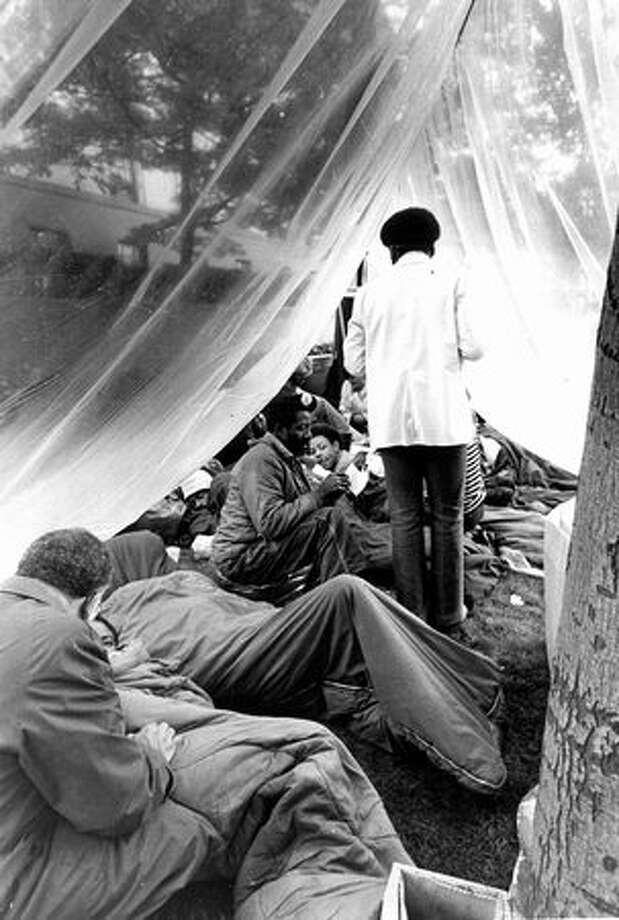 This previously unpublished June 13, 1972 photo shows construction workers and supporters camped on the U.S. Courthouse lawn. They planned a 50-hour vigil to influence court decision on recruiting minority apprentices, putting them on construction jobs. (seattlepi.com) Photo: P-I File