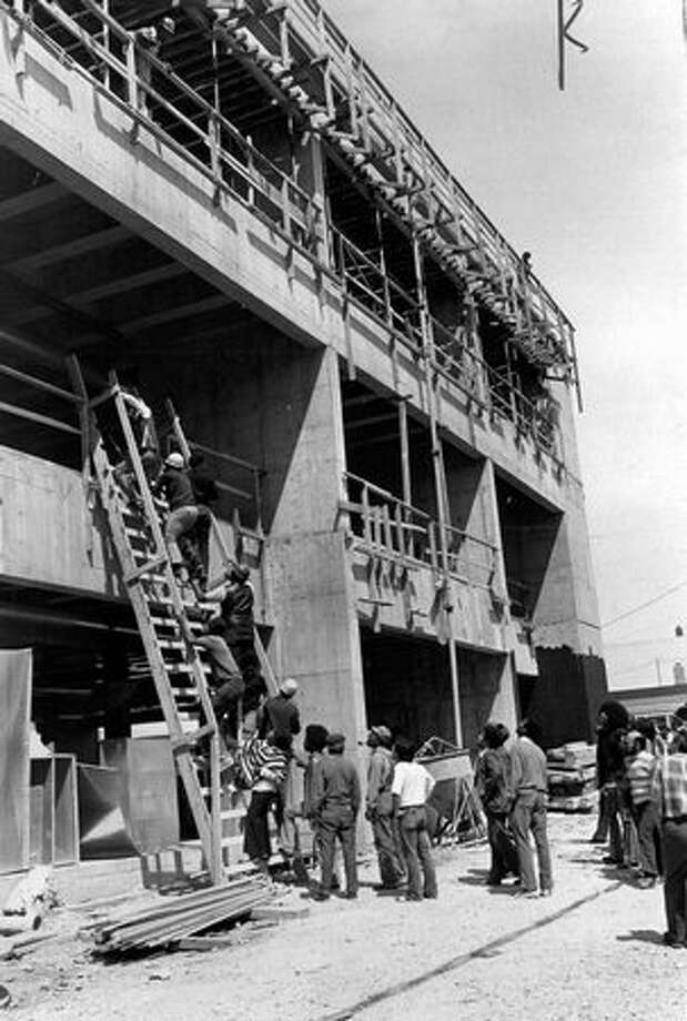 The photo caption for this previously unpublished June 6, 1972 P-I photo states the men are going up the ladder to beat up white men at SCCC. (Phil Webber/seattlepi.com file) Photo: P-I File