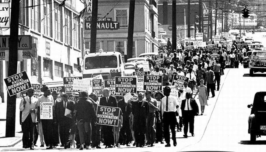 This June 1963 Seattle march was about inequality in employment, education and housing and sponsored by the Congress on Racial Equality and the National Association for the Advancement of Colored People. (seattlepi.com file) Photo: P-I File