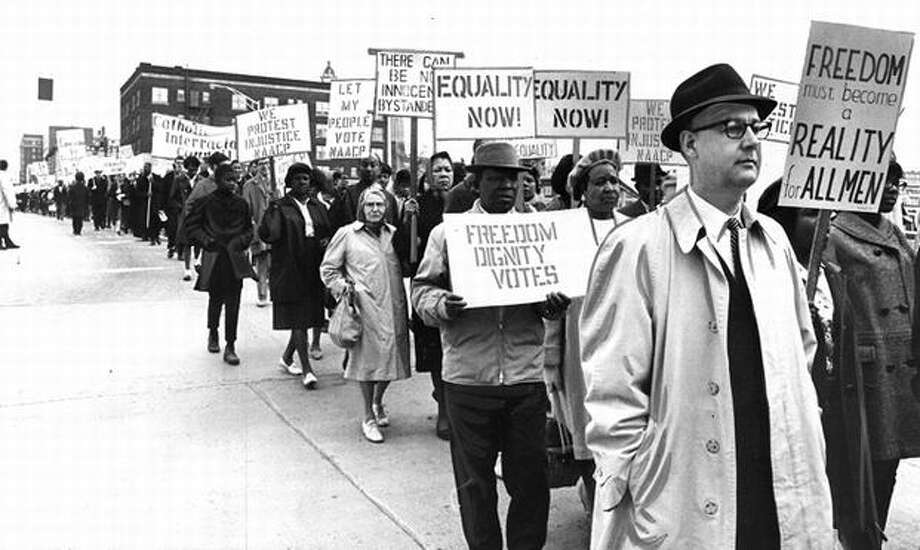 This March 1965 photo shows people marching down Madison Street to the U.S. Courthouse. (seattlepi.com file) Photo: P-I File