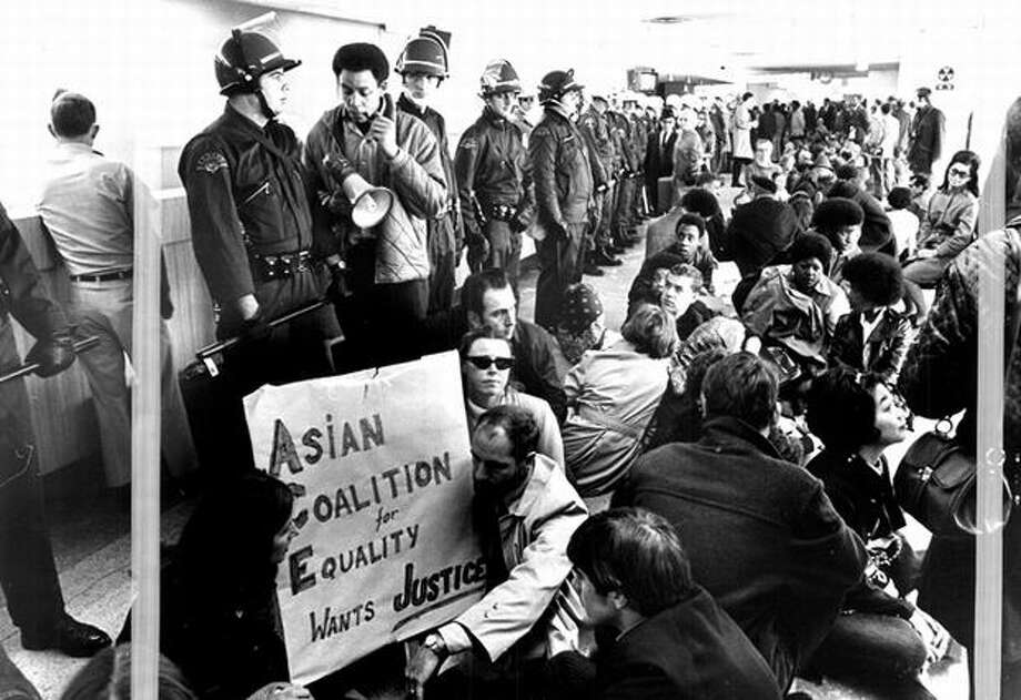 The Nov. 6, 1969 photo caption read: Jobs-for-blacks demonstrators held sit-in near Sea-Tac ticket counters. Police from Seattle, King County and area towns lined the counters to keep protestors away. (seattlepi.com file) Photo: P-I File