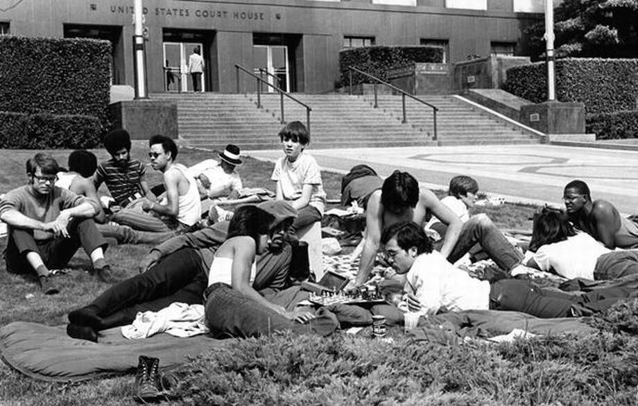 "The June 13, 1972 photo caption read: Black construction workers and supporters ""camped"" on the U.S. Courthouse lawn yesterday. They planned 50-hour vigil to influence court decision on recruiting minority apprentices, putting them on construction jobs. (seattlepi.com) Photo: P-I File"