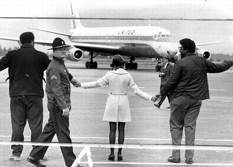 The Sept. 24, 1969 photo caption read: Demonstrators for more black jobs joined hands on Sea-Tac's flight line. The United Airlines plane above was held up five minutes before passengers debarked. (Cary Tolman/seattlepi.com file) Photo: P-I File