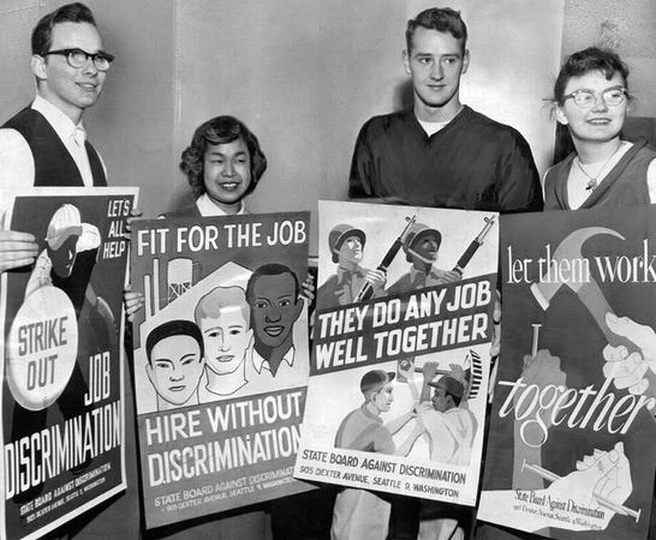 The March 1954 photo caption read: Winning posters in contest sponsored by the State Board Against Discrimination in Employment are displayed by their creators, all of whom are Edison Technical School advertising art students. From left are William Nilsen, Shizuko Tokito, Donald Winsor and Marline Howard. Nilsen's entry won the top award. (seattlepi.com file) Photo: P-I File