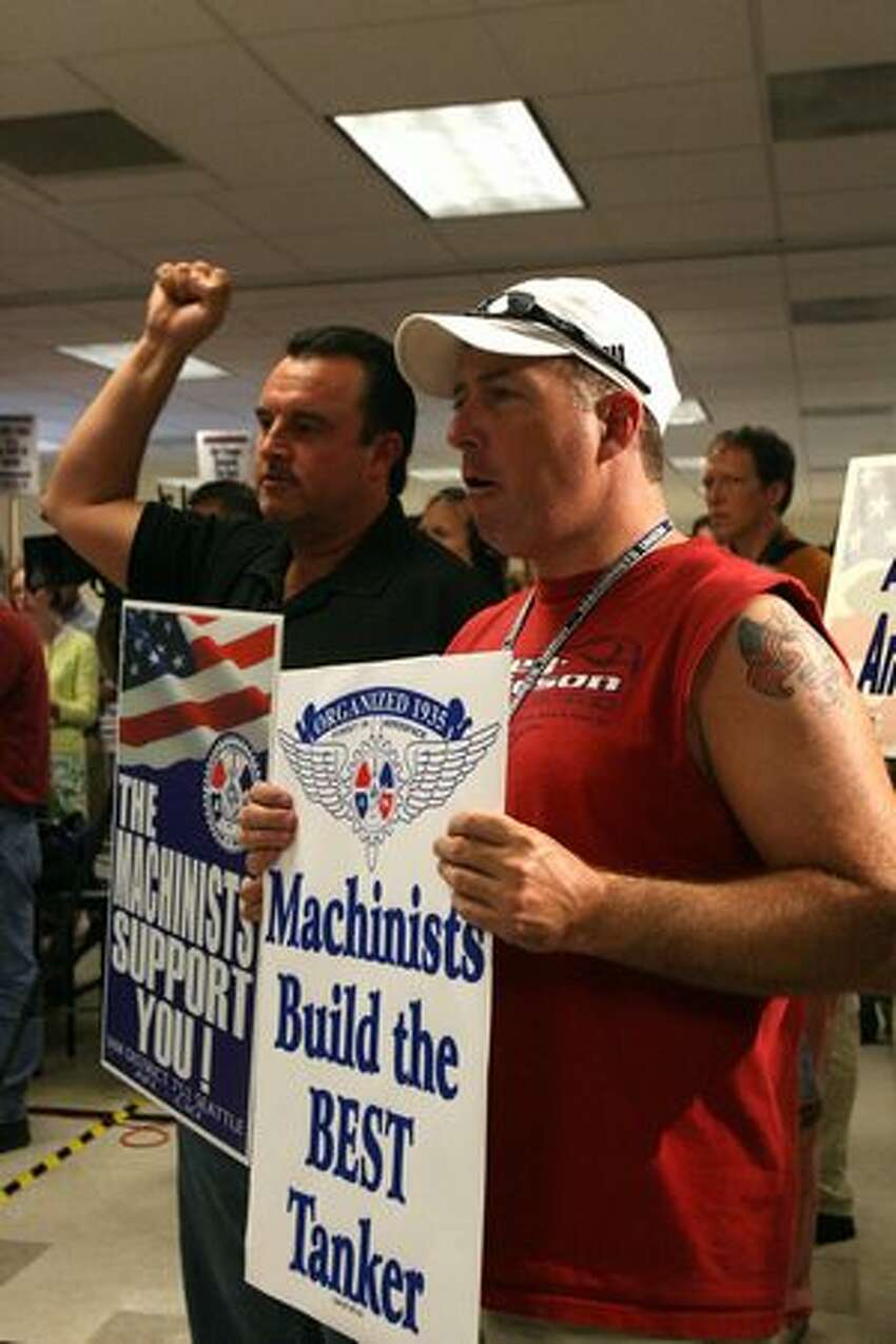 Stosh Tomala (left), who works at IAM-Boeing Joint Programs, and Machinist Pat Bertucci rally in support of Boeing's U.S. Air Force aerial refueling tanker bid at the International Association of Machinists and Aerospace Workers District 751 hall in Everett, Wa.