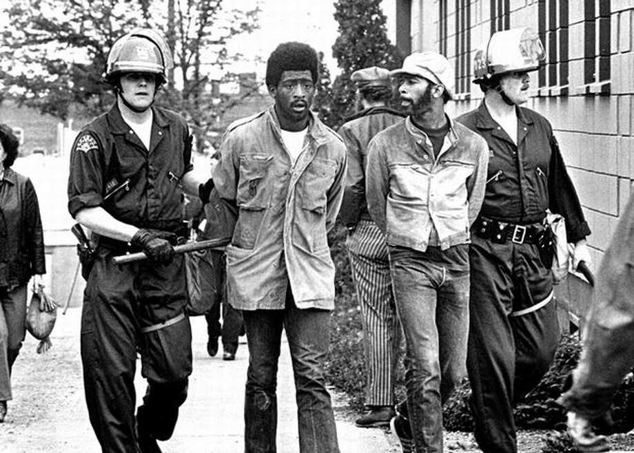 The photo caption for this previously unpublished June 22, 1972 P-I photo reads: Two of more than 50 black construction workers and their supports were arrested early Thursday morning after climbing a rear fence to enter the SCCC [Seattle Central Community College] construction site. (seattlepi.com) Photo: P-I File