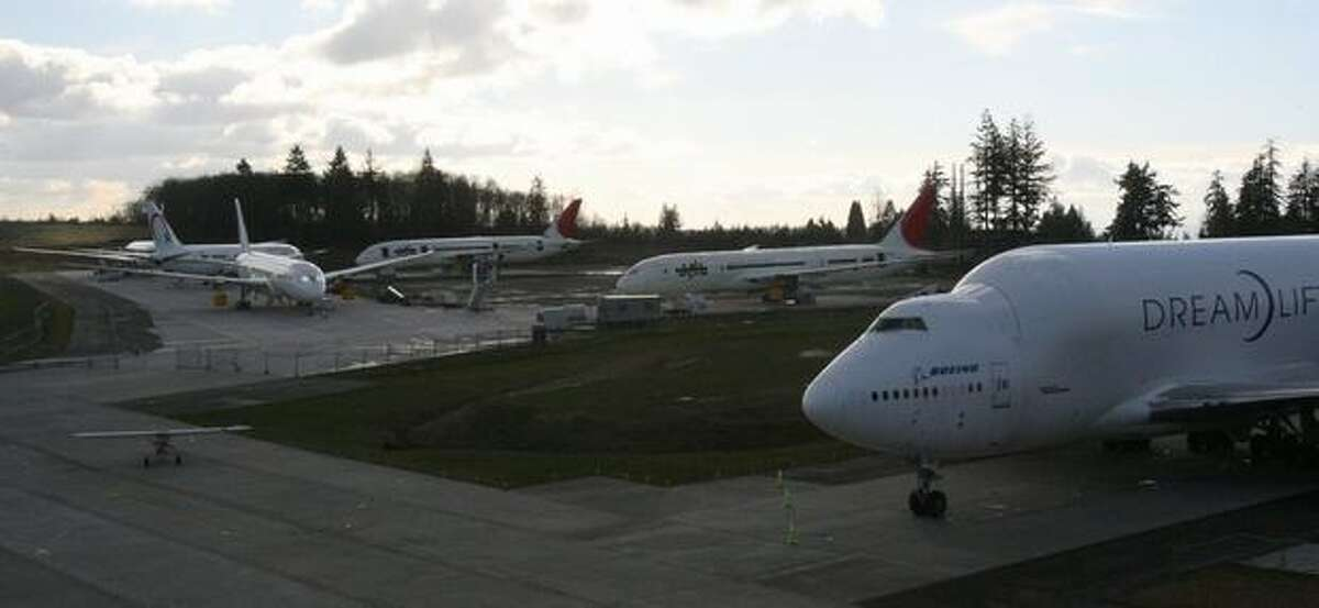 A Boeing Dreamlifter and 787 Dreamliners sit beside the Future of Flight Aviation Center at Paine Field, in Everett, Wash.