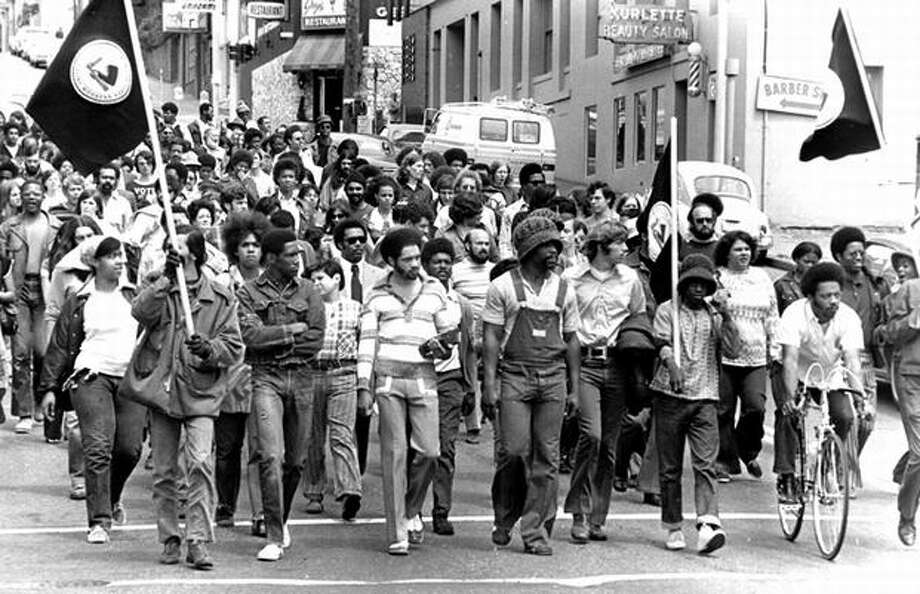 The caption for this previously unpublished July 7, 1972 P-I photo reads: United Construction Workers Association members and their supporters, about 200 strong, march down Madison Street to the federal courthouse. (Bob Miller/seattlepi.com file) Photo: P-I File