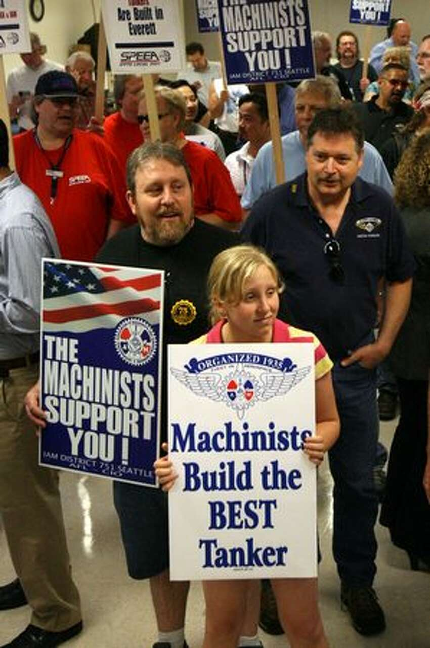 Machinist Rich Holman (left), a tool room clerk, and daughter Adanne Holman, 11, rally in support of Boeing's U.S. Air Force aerial refueling tanker bid at the International Association of Machinists and Aerospace Workers District 751 hall in Everett, Wa.
