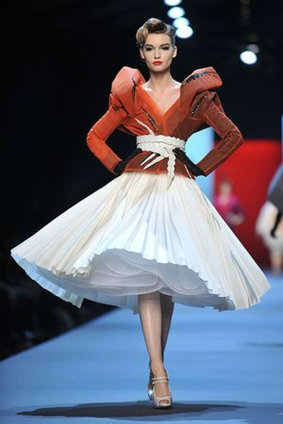 A model walks the runway during the Christian Dior show as part of the Paris Haute Couture Fashion Week Spring/Summer 2011 at Musee Rodin in Paris, France.