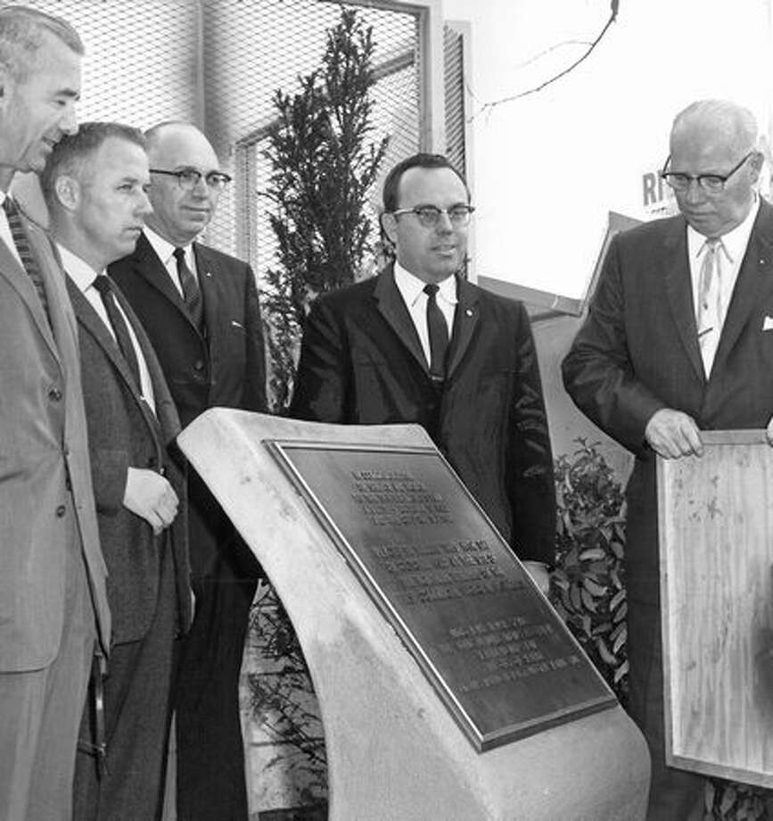 "The October 1962 caption read: Dedicating a bronze plaque marking the ""first commercial monorail in the United States"" are left to right, Roy W. Morse, Seattle city engineer, Arnold Anderson, Alweg representative; Ed Booth, president, American Public Works Association; Robert Bugher, association director, and Howard Culver, city treasurer. Photo: P-I File"