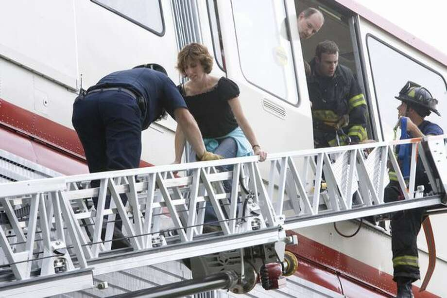 Jan Wagner is guided down the rescue ladder from the red Monorail after an electrical problem, Aug. 23, 2008. (Grant M. Haller/Seattlepi.com file) Photo: P-I File