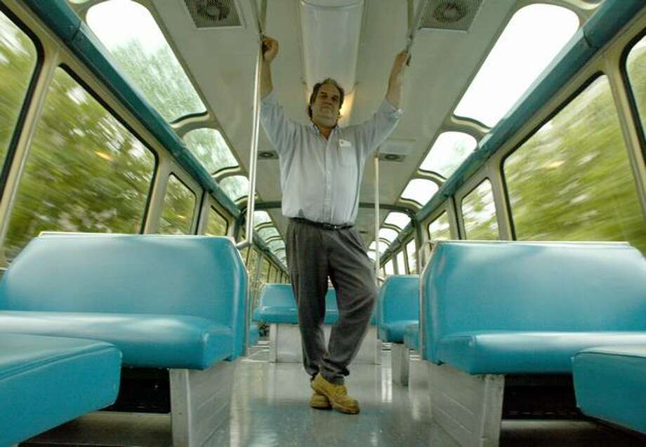 The Sept. 19, 2002 caption read: Seattle cabbie Dick Falkenbury is the guy who came up with the Monorail initiative. Photo: P-I File