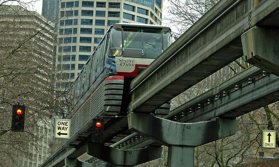 The Seattle Center monorail makes a test run down Fifth Avenue, Dec. 14, 2004. Photo: P-I File