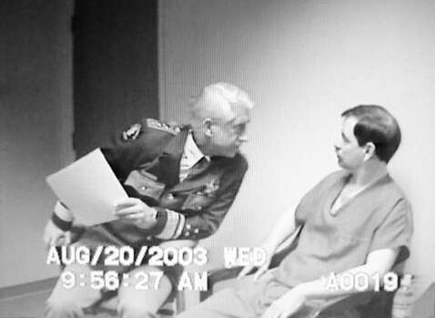King County Sheriff Dave Reichert, left, stares intently at Green River Killer Gary Leon Ridgway in this image from video taken from an Aug. 20, 2003, interrogation of Ridgway near Seattle. The image is from more than 400 hours of Ridgway video released Feb. 9, 2004, by the King County Prosecutor's Office in Seattle. Ridgway pleaded guilty in 2003 to 48 counts of aggrevated first-degree murder in killings from 1982-1991. (AP Photo/Coutesy King Co. Prosecutor's Office)